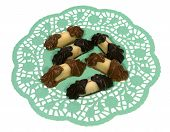 picture of doilies  - Chocolate and marzipan on a green filigree doily paper over white - JPG