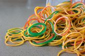 stock photo of rubber band  - Colorful Rubber Band three colors mixed together - JPG