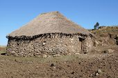 stock photo of ethiopia  - Traditional homes in the upland of Amhara, Ethiopia, Africa