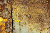 pic of goldenrod  - rusty iron surface covered with old paint - JPG