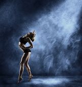 foto of break-dance  - Dancing Woman Sexy Girl Posing in Expressive Sport Dance Fitness Dancer Athletic Body Artist over blue grunge background - JPG