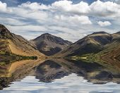stock photo of reflection  - Stunning landscape of Wast Water with mountains reflected in calm lake water in Lake District - JPG