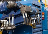 picture of hydraulics  - Hydraulic tubes fittings and levers on control panel of lifting mechanism - JPG