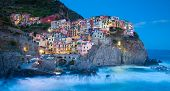 image of cliffs  - Manarola fisherman village in a dramatic windy weather - JPG
