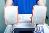pic of defibrillator  - CPR device in doctors hand - JPG