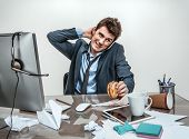 pic of loafers  - Man rubbing his neck with hand at working place sloth and laziness concept - JPG