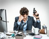 foto of suicide  - Young businessman with gun wants to commit suicide  - JPG