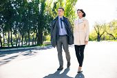 picture of girl walking away  - Portrait of a beautiful couple walking in park - JPG