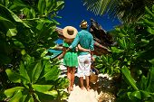 image of foliage  - Couple walking to the beach Anse Source d - JPG