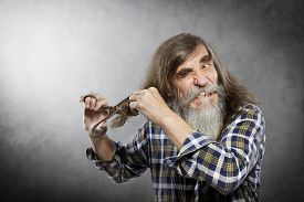 pic of long beard  - Old Man Scissors Cutting Hair Senior with Crazy Face Self Trim Long Hair - JPG
