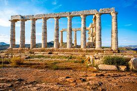 stock photo of poseidon  - Poseidon temple landmark at the sunset in Sounion - JPG