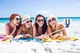 picture of selfie  - Happy friends wearing sun glasses and taking selfie at the beach - JPG