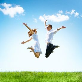 stock photo of jumping  - Happy Couple Outdoor - JPG