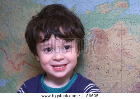 Picture or Photo of The portrait of a boy at the map