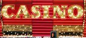 stock photo of keno  - Red and gold color neon casino sign - JPG