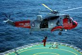 foto of cruise ship  - royal navy helicopter completes a risky medical evacuation from a cruise ship at sea - JPG