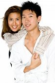 stock photo of asian woman  - A young Asian couple holding each other on white background - JPG
