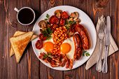Traditional Full English Breakfast With Fried Eggs, Sausages, Beans, Mushrooms, Grilled Tomatoes And poster