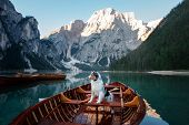 Dog On Lake Braies In Italy. Australian Shepherd In A Boat. Pet Travel, Adventure poster