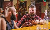 Interesting Conversation. Hipster Brutal Bearded Man Spend Leisure With Friend At Bar Counter. Men R poster