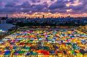 Color Full Of Train Night Market Ratchada, Bangkok Thailand. The Famous Bangkok Night Market. Coulou poster