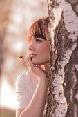 Beautiful Girl With Flower Dreaming At Nature At Tree Trunk. Wonderful Lovely Young Woman Hiding Beh poster