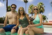 image of early 60s  - Two Women and a Man at the Pool - JPG