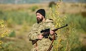 Man Brutal Gamekeeper Nature Background. Hunter Hold Rifle. Bearded Hunter Spend Leisure Hunting. Fo poster