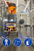COLOGNE, GERMANY - MARCH 27 : New Clean In Place system with work safety pictograms on display at th