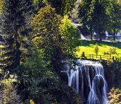 Travel to Croatia. Sunny lawn at the waterfall. The Croatian town of Slunj. Cascade of waterfalls on poster