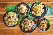 Papaya Salad Served On Dining Table / Green Papaya Salad Spicy Thai Food On Plate With Fresh Vegetab poster
