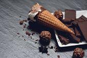 Ice Cream Cone With Chocolate Bar And Ball On Dark Background / Ice Cream Vanilla Covered Chocolate  poster