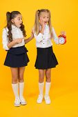 Time For Break And Relax. Alarm Ringing. Time For Lunch. School Schedule. Schoolgirls And Alarm Cloc poster