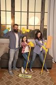 Family Mom Dad And Daughter With Cleaning Supplies At Living Room. We Love Cleanliness And Tidiness. poster