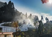 Japanese Peace Pagoda, On The Top Of Mountain In The Darjeeling, In A Haze Of The Arising Clouds Whi poster