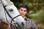 Teen with white horse