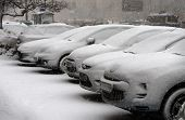 stock photo of freezing temperatures  - Cars are under snow during a snowfall - JPG