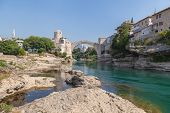 MOSTAR, BOSNIA - AUGUST 10: The Old bridge and town on the Neretva River on August 10, 2012 in Mosta