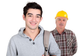 foto of peppy  - Young man standing next to an experienced worker - JPG
