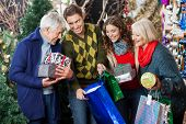 Happy family with shopping bags and presents in Christmas store