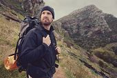 image of wild adventure  - Portrait of adventure trekking man in mountains with backpack - JPG