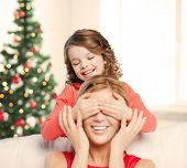 christmas, x-mas, winter, happiness concept - mother and daughter making a joke
