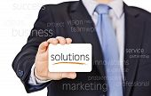 pic of courtesy  - businessman offer solutions with a business card - JPG