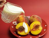 Peaches And Cream Complexion Concept With Plate Of Fresh Yellow Peaches With Pouring Glass Crystal J
