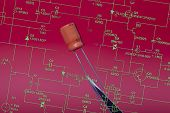 pic of capacitor  - Detail of one capacitor in red background  - JPG