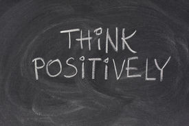 pic of think positive  - think positively slogan handwritten with white chalk on blackboard with strong eraser smudges - JPG