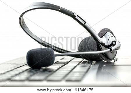 Headset On A Laptop Computer poster