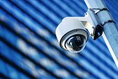 stock photo of circuits  - close up of security camera and urban video - JPG