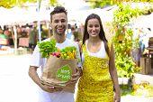 stock photo of papaya fruit  - Happy couple  shopping at a open street market - JPG