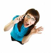 Girl With Glasses Emotionally Speaks On The Phone On White Background. View From Above